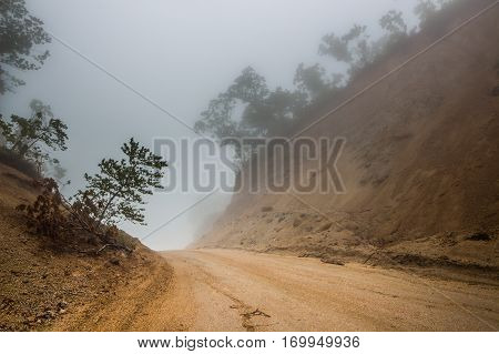Foggy road. Offroad. Track. Fog. Mystical way. Drty road