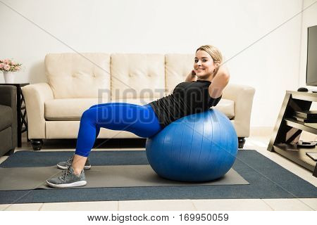 Cute Hispanic Woman Working Out At Home