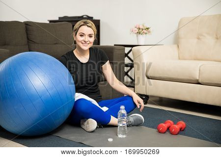 Pretty Girl Resting After Working Out At Home