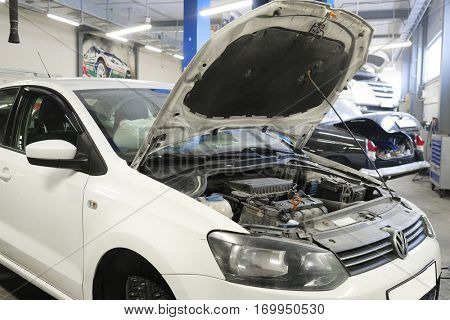 Moscow, Russia, December, 15, 2016: Car with an open hood in a repair station