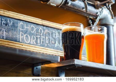Pale Ale And Stout On A Counter