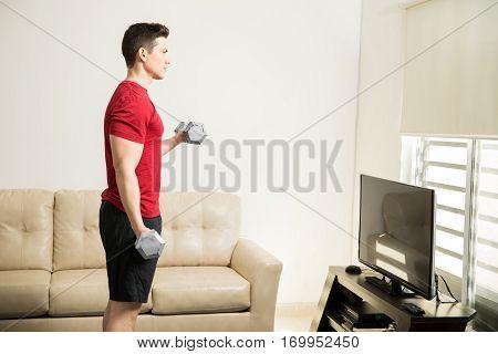 Strong Man Lifting Weights At Home