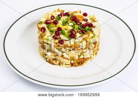 Dish of squid with beans permanganate. Studio Photo