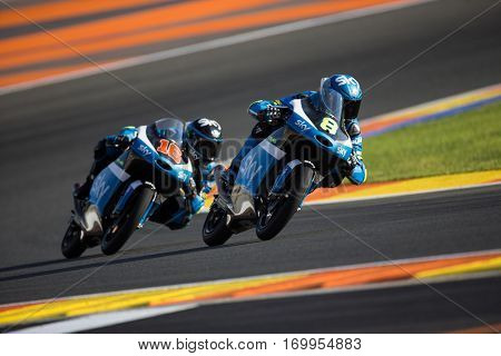 VALENCIA, SPAIN - NOV 11: 8 Bulega, 16 Migno during Moto3 practice in Motogp Grand Prix of the Comunidad Valencia on November 11, 2016 in Valencia, Spain.