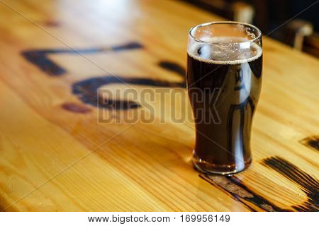 Pint Of Stout On A Table