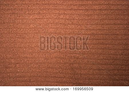 Close-up of brown polar fleece fabric, material texture background