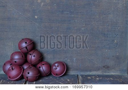 Christmas border with sleigh bells on wooden background
