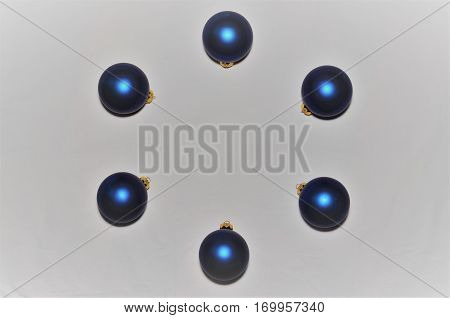 Circle of blue Christmas ornaments border on white background