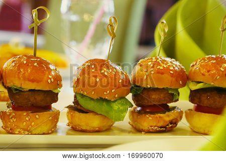 Mini Hamburger With Salad Leaf Served On The Plate