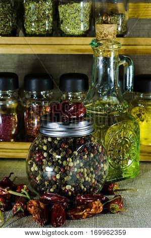 Small Bottle With Sunflower Oil With Jar Of Whole Pepper.