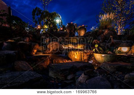 Waterfall fountain landscape at night creates a soothing ambiance