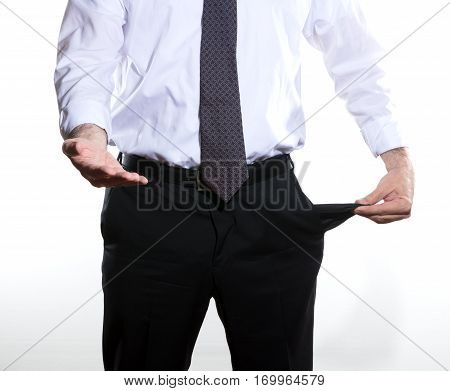 businessman showing his pockect empty asking for money he wears a gray tie and trousers and white shirt