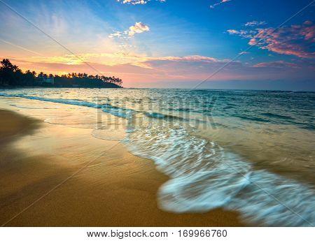 Sunset view of tropical beach in Mirissa, Sri lanka