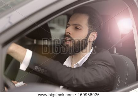 Businesmen driving carefuklly