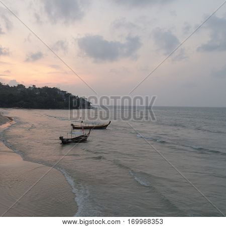 Aerial view of fishing boats in sea at beautiful sunset, Thailand
