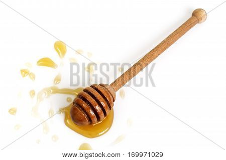 Freshly fragrant honey into a bowl and dipper on white background. Studio Photo