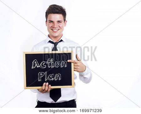 Action Plan - Young Smiling Businessman Holding Chalkboard With Text