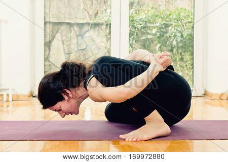 Woman Doing Yoga At Home - Marichyasana- Marichyasana B