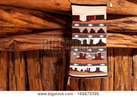 Traditional handmade wool Navajo rug with Monument Valley elements