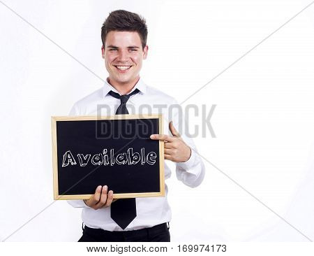Available - Young Smiling Businessman Holding Chalkboard With Text