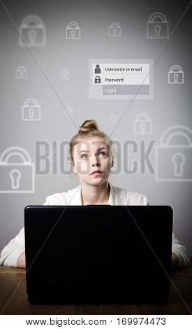 Young slim woman is using a laptop to browse the net. Forgot password concept.