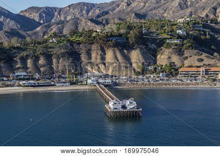 Malibu, California, USA - December 17, 2016:  Afternoon aerial of Malibu Pier and the Santa Monica Mountains.