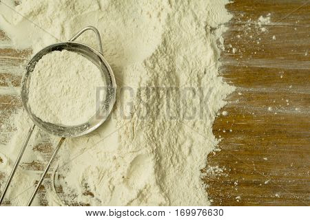 Strainer full of flour to sift it on the table