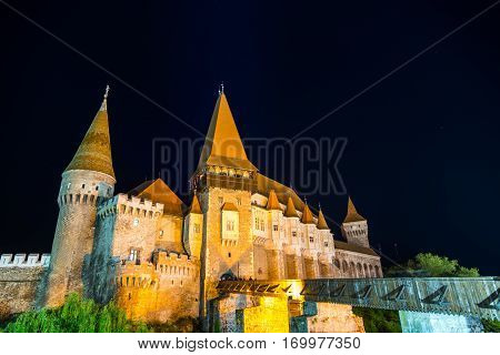 Hunedoara, Romania - May 17, 2015: Tourists visiting Corvin Castle, also known as Hunyadi Castle or Hunedoara Castle which is a Gothic-Renaissance castle in Hunedoara, Romania