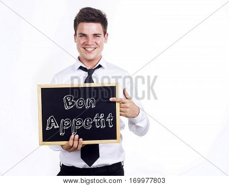 Bon Appetit - Young Smiling Businessman Holding Chalkboard With Text