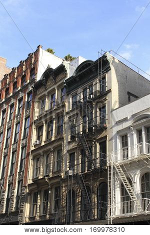 buildings with fire escape stairs in downtown New York City