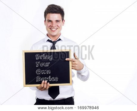 Bring Your Own Device Byod - Young Smiling Businessman Holding Chalkboard With Text