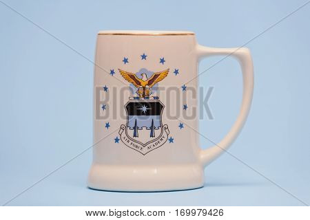 PLEASANT VALLEY CANADA - FEBRUARY 09 2017: Air Force Academy mug on  blue. The United States Air Force Academy is a training school for officer cadets in the U.S. Air Force. It is located in Colorado.