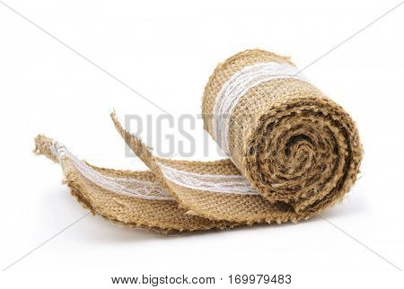 rustic burlap ribbon ornamented with white lace used to gift wrapping, on a white background