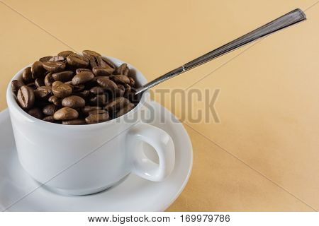 The A coffe cup with coffe beans