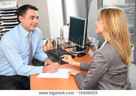 People in the office signing contract