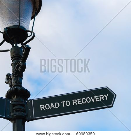 Road To Recovery Directional Sign On Guidepost
