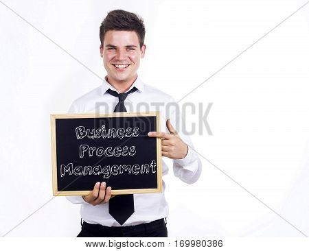 Business Process Management Bpm - Young Smiling Businessman Holding Chalkboard With Text