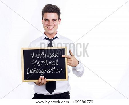 Business Vertical Integration - Young Smiling Businessman Holding Chalkboard With Text