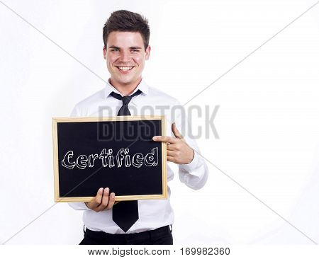 Certified - Young Smiling Businessman Holding Chalkboard With Text