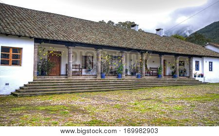 View of a section of an old colonial hostel hacienda, on the outskirts of the city of Ibarra, Ecuador.