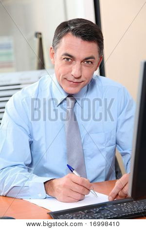 Salesman working in front of computer