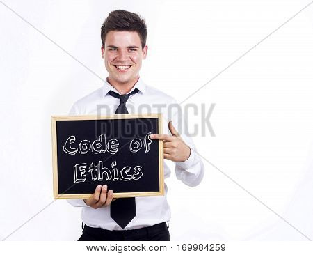 Code Of Ethics - Young Smiling Businessman Holding Chalkboard With Text