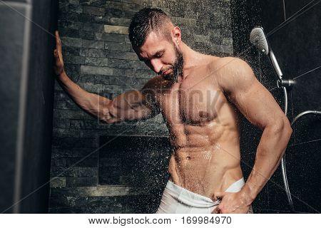 Shirtless, Muscular Man Taking A Shower In Modern Bathroom