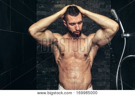 Fitness Handsome Man Taking A Shower In The Morning. Natural Looking Athlete Showering