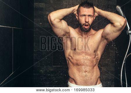 Handsome, Naked Man Taking Shower. Muscular Man Showering After Workout