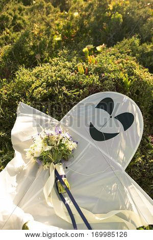 Wedding bouquet and kite flying on the grass