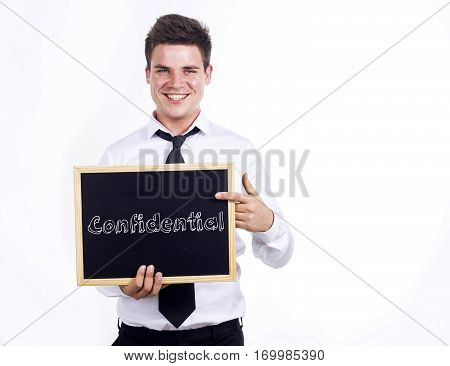 Confidential - Young Smiling Businessman Holding Chalkboard With Text