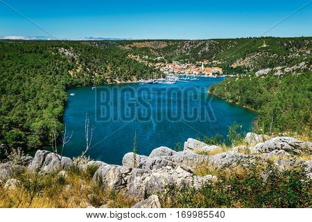 Town Of Skradin On Krka River In Dalmatia, Croatia Viewed From Distance. Skradin Is A Small Historic