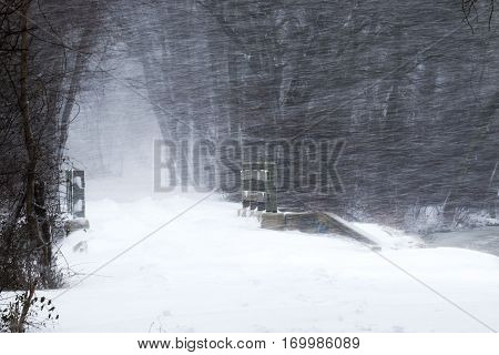 Sideways snow blowing over the wood bridge in Southards pond PArk Babylon NY