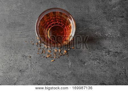 Water shortage concept. Glass of dirty water on grey background